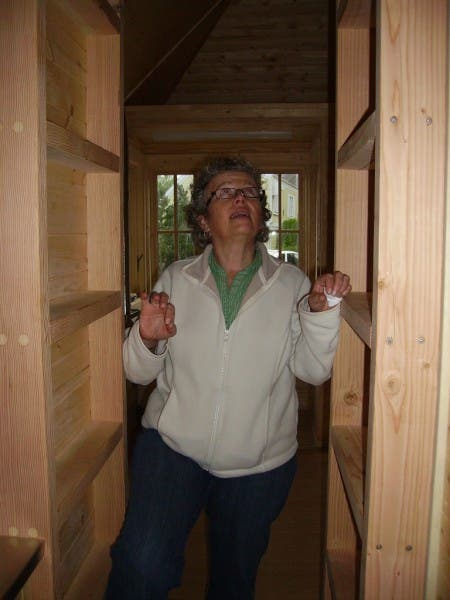 My mom getting ready to climb into the loft.