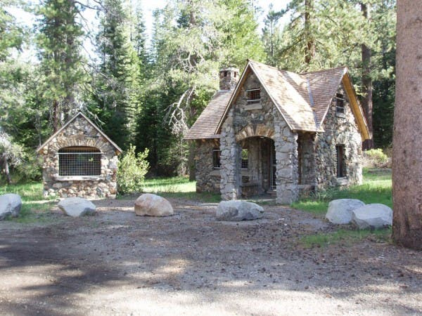 Tiny house in a landscape for Stone log cabin