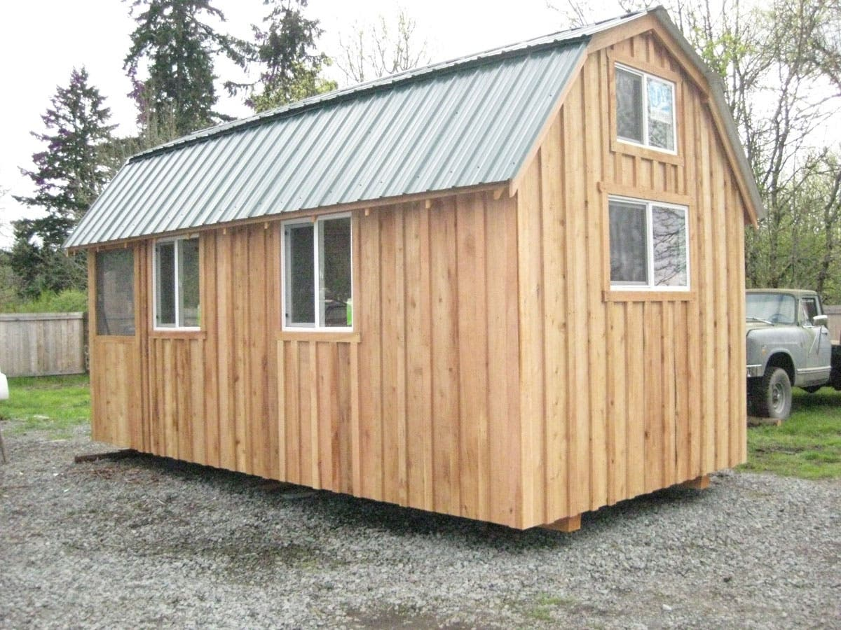 Tiny barn cabin for sale with land and rv hook ups for Sheds and barns