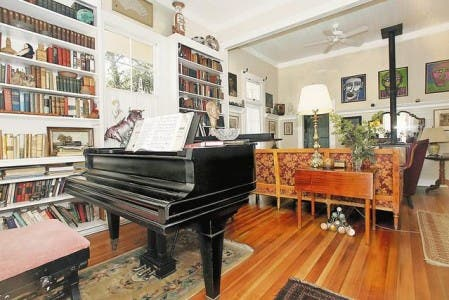 Unexpectedly, a grand piano greets visitors to the 500-square-foot home of Richard Steen and Jefferson Bailey. The home also features large artwork, antiques and a remodeled kitchen and bathroom.