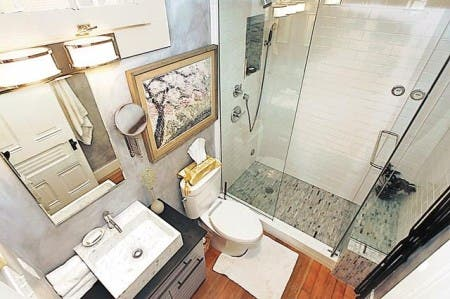 The remodeled bathroom includes a steam shower. Steen and Bailey used to live in a home with four bathrooms.