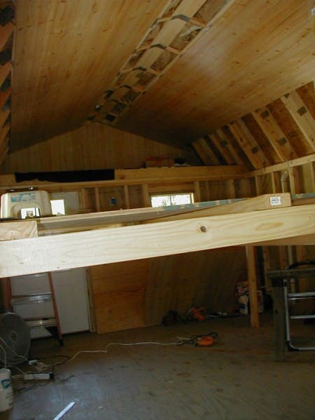 A temporary scaffolding was used to give workers the ability to reach high enough to do their insulation and paneling work on the ceiling.