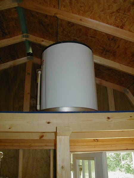 The 30 gallon hot water tank was placed up in one of the loft areas.