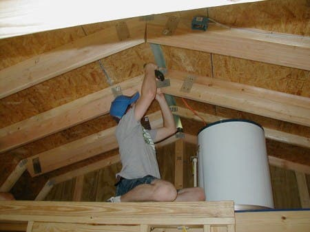 "The R-30 insulation requires about 10 inches of clearance so you have to ""add to"" the 3 1/2 inches of 2X4 rafters to increase their depth to almost 10 inches to make room for the thick insulation sheets."