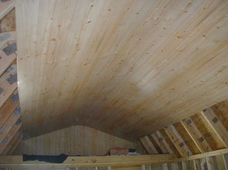 The wood paneling is slightly flexible and it can form an arch at the peak of the ceiling to eliminate a seam.