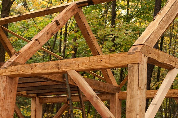Sustainable hand hewn timber frame for Hand hewn log cabin for sale