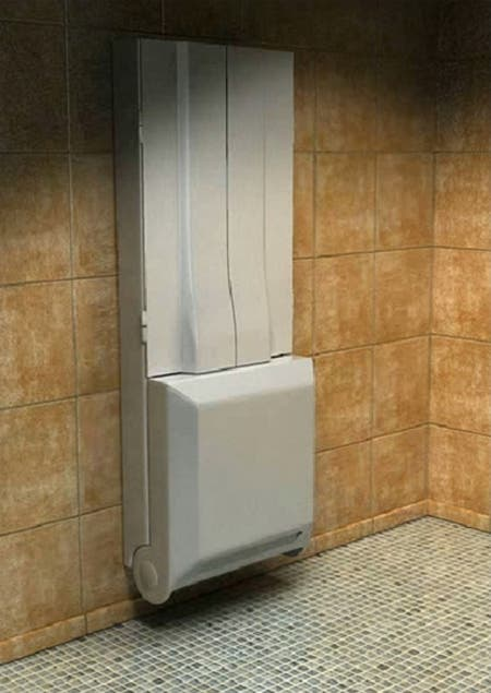 For a tiny house or small studio apartment a folding shower just might be  the answer. This shower when folded up looks like a built-in cabinet.