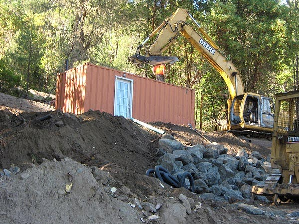 The Container Being Delivered to Site