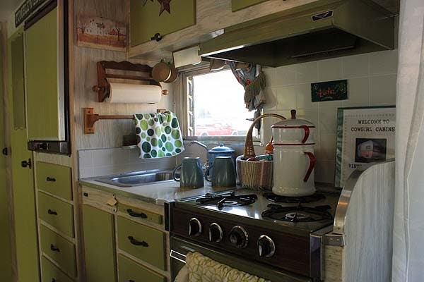 kitchen of green vintage trailer