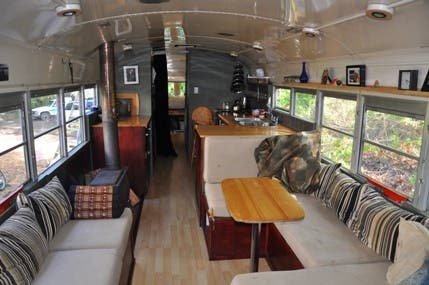 Family lives in a converted 40 foot bus named eliza brownhome for Living 3000 shop