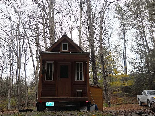 front of tiny house facing brook