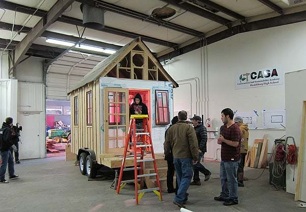 advanced construction students and tiny house