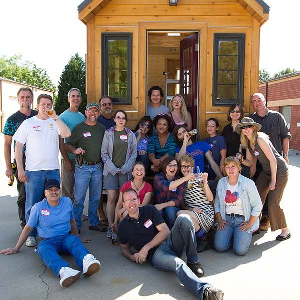 workshop crew in front of tiny house