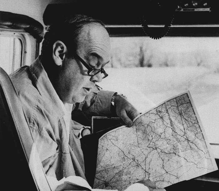 "CBS newsman Charles Kuralt is shown reading a map in the driver's seat of his ""On The Road"" motorhome. (AP Photo/File)"