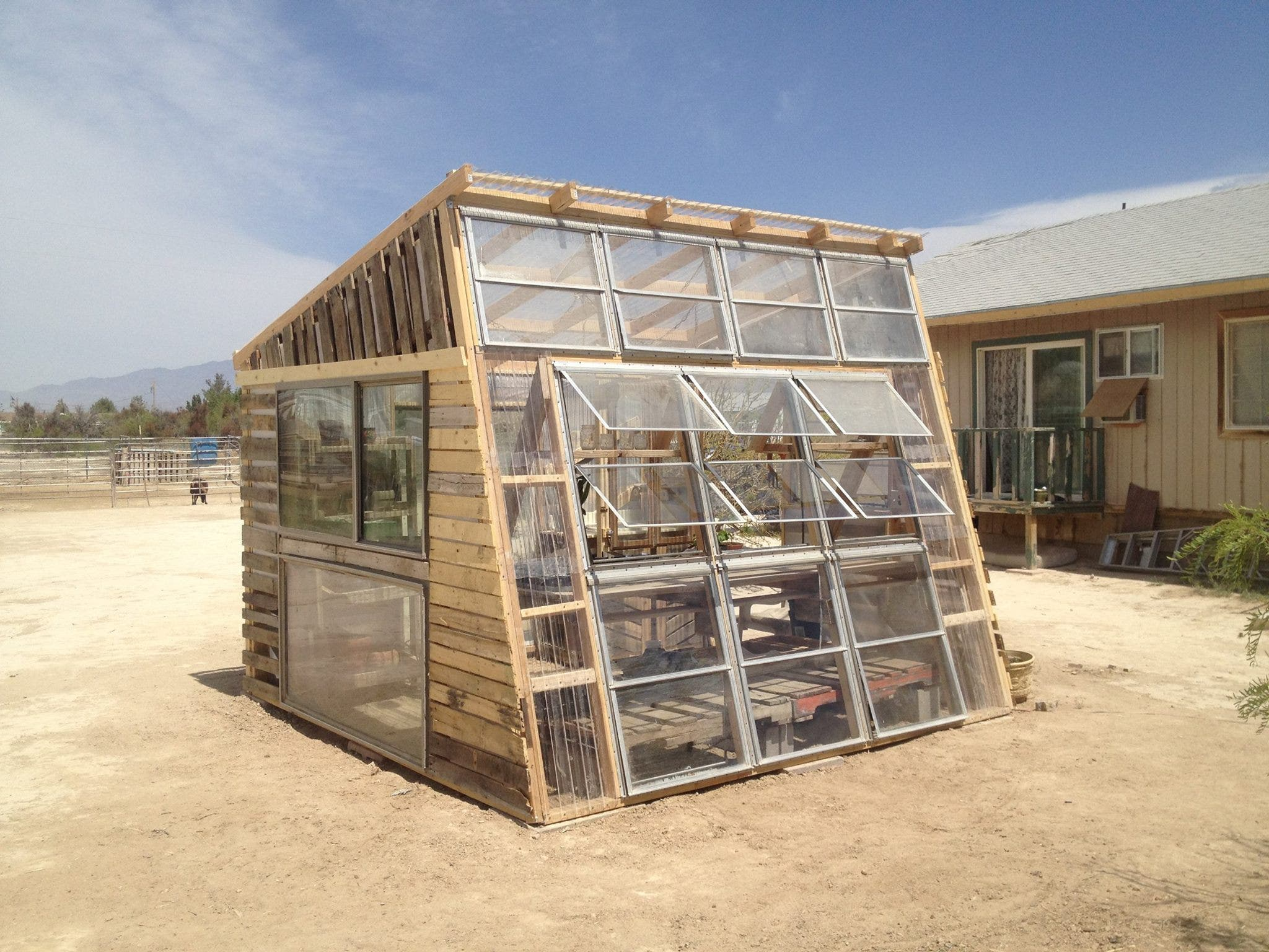 We quit our jobs to ride our bicycles for Tiny house with greenhouse