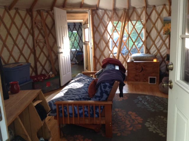 (looking into the big yurt with baby yurt beyond)