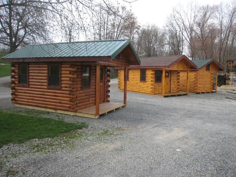 Trophy amish log cabins tiny house blog for Tiny hunting cabin