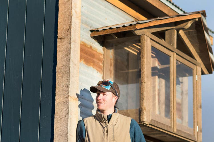 Spice Box Homes owner and simple living expert Chris Curry in front of his latest build.
