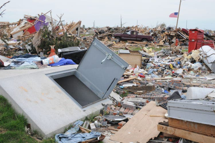 Moore, OK, June 8, 2013 -- This new style storm shelter survived the May 20 EF5 tornado while most houses in the neighborhood did not. Many safety officials and FEMA Hazard Mitigation suggest the best place to be in this type of storm is underground. George Armstrong/FEMA