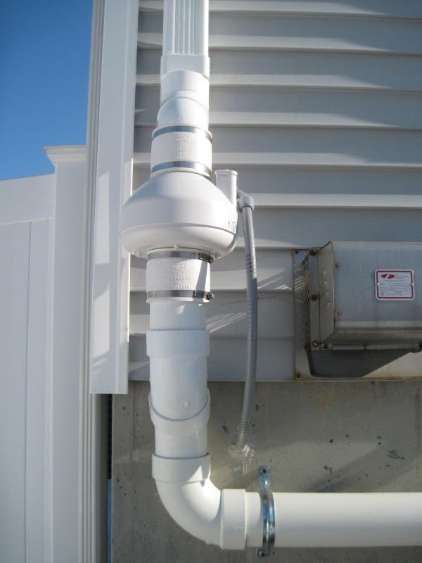 A typical exterior radon fan installation.