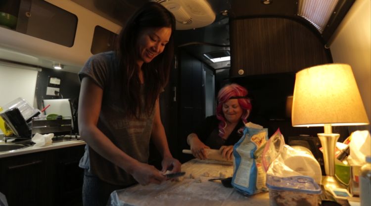 Eva and Krissee make dumplings to share