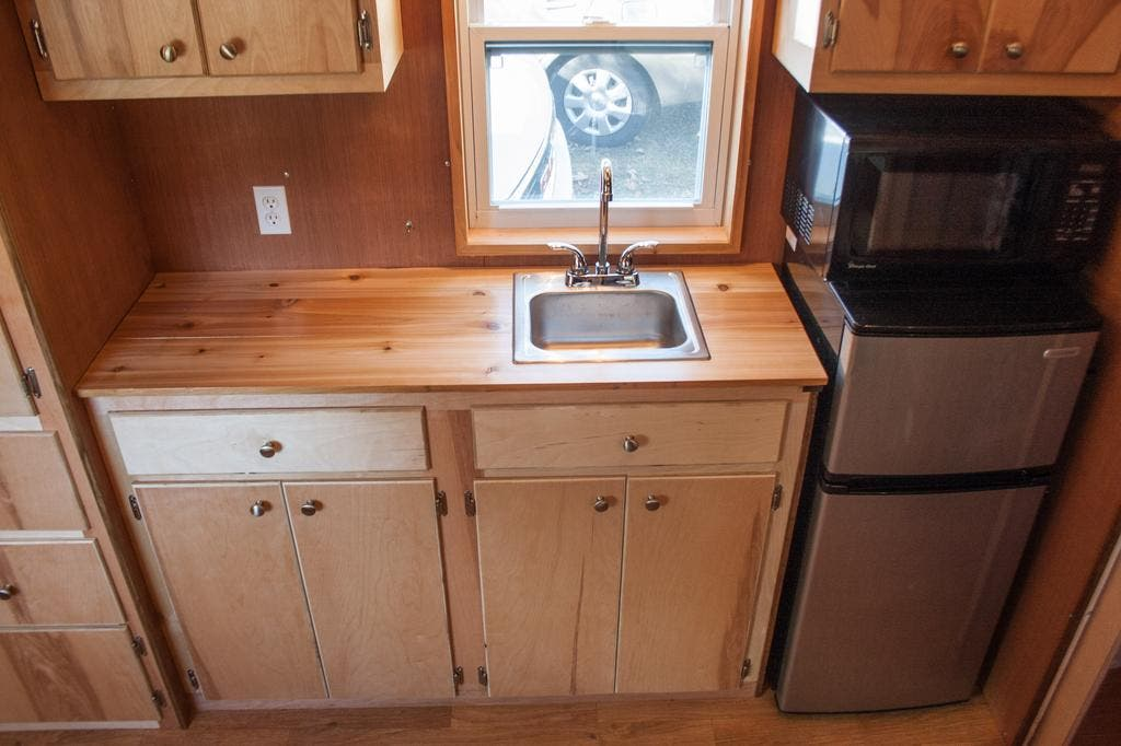 Trimmed Inside And Outside With Beautifully Finished Cedar This Tiny House On Wheels Is Perfect For Anyone Who Loves The Smooth Natural Aesthetic Of Wood