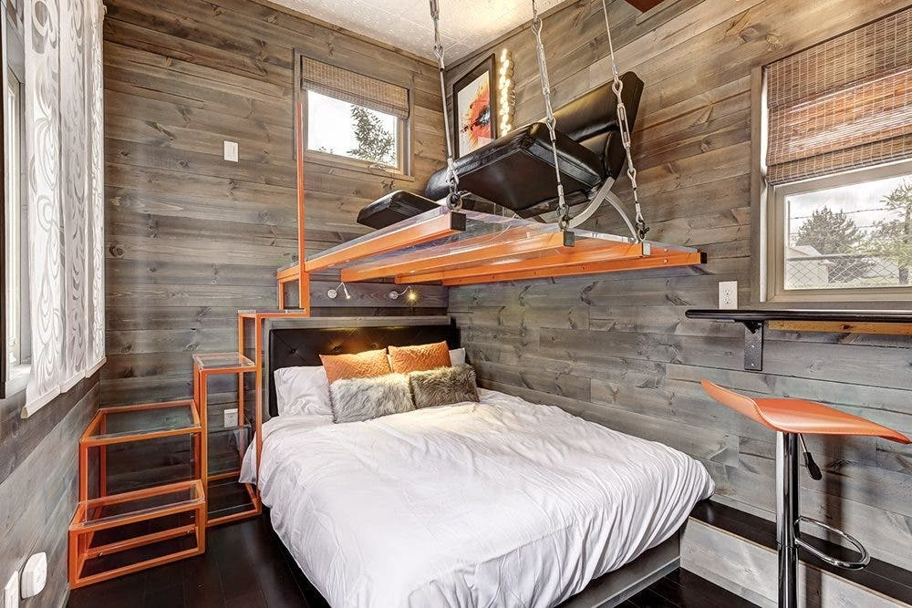 the modern tiny house features a bed with a hanging lounger above it - Tiny House Modern