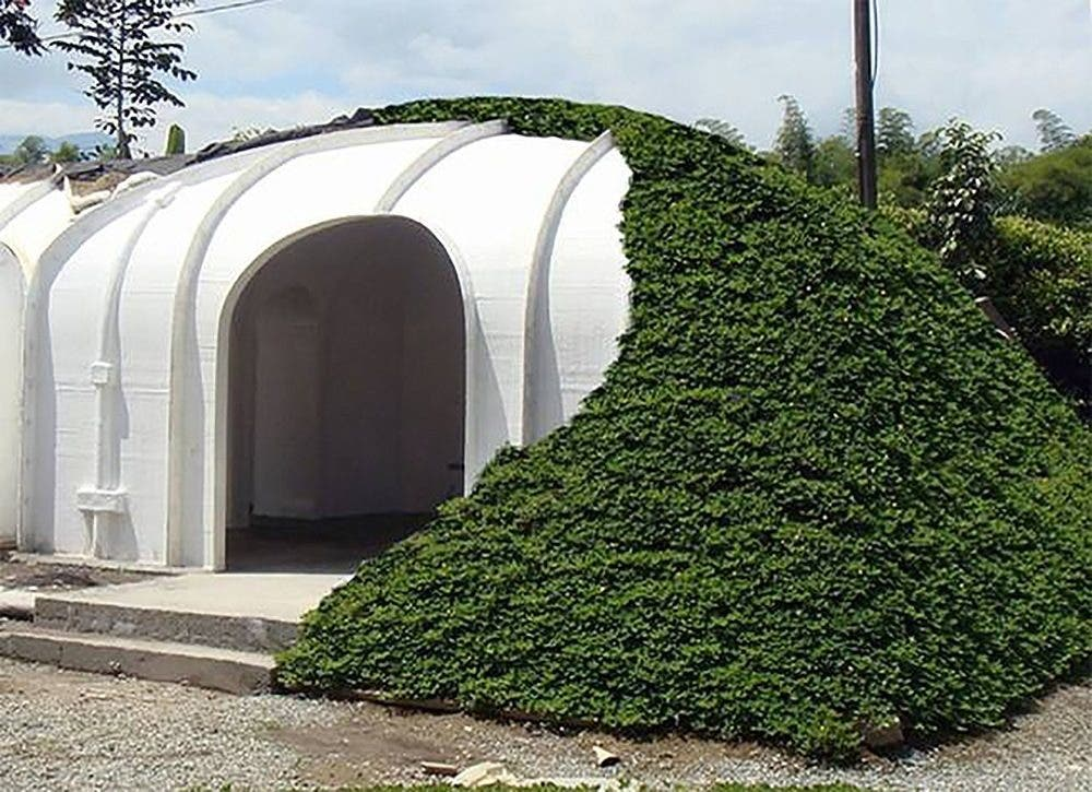Futuristic underground hobbit house by green magic homes for Cost to build shell of house