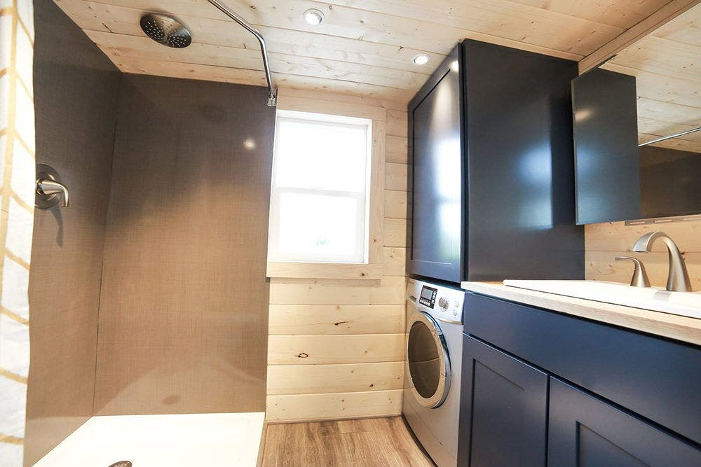 the mansions bathroom has enough room for a washerdryer combo