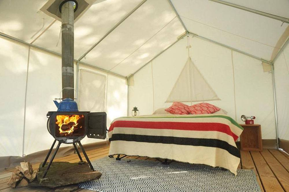 Each tent has a bed lighting heat and access to an outdoor grill for cooking. & Stay in a Luxury Bunk Tent with Tentrr - Tiny House Blog