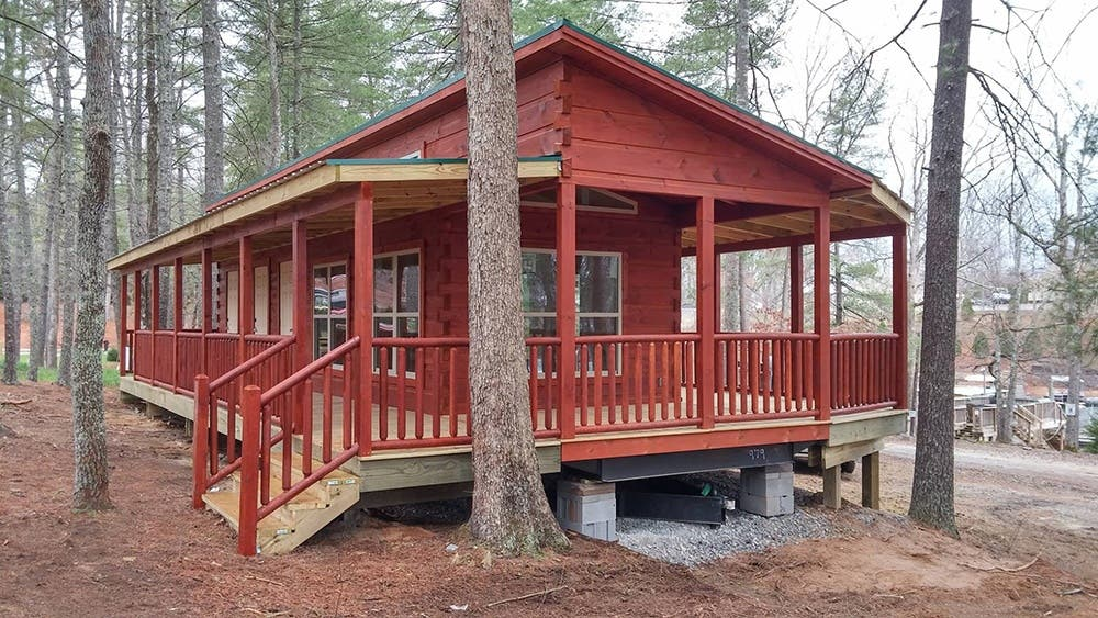 Green river log cabins builds custom park models in 3 for Foundation tiny house builders