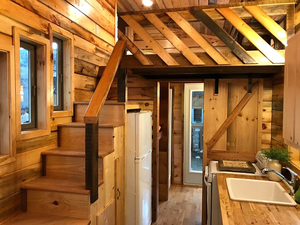 In addition to building custom homes the company also offers the tiny home university this intensive workshop teaches you how to build your own house in