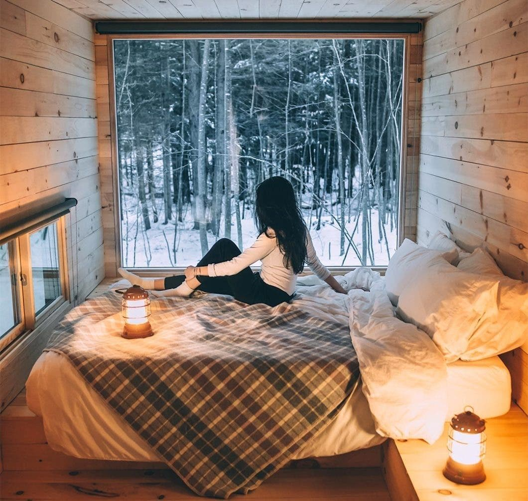 Woman on Getaway bed in cabin