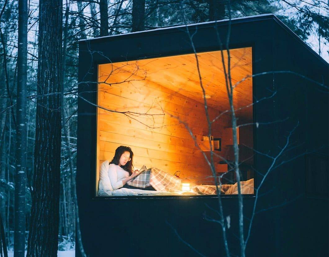 Woman in tiny house window